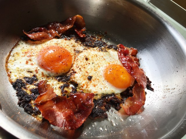 baked eggs on hash browns with glazed bacon