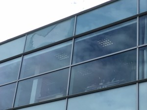 Broken window on the top storey at the Lakeside Doncaster