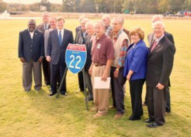 About 125 people including state, local and federal officials were on hand Friday morning at BNA Park for the official designation of Highway 78 as Interstate 22. Among those shown in the photo above are State Representative Margaret Rogers, former Transportation Commissioner Zack Stewart, former State Representative John David Pennebaker, Northern District Transportation Commissioner Mike Tagert, and U. S. Senator Roger Wicker