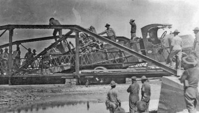 This army truck fallen through a wooden bridge was typical of the daily problems Lt. Colonel Dwight Eisenhower experienced during the 1919 truck convoy from Washington to San Francisco.