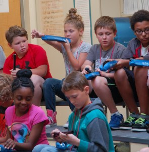 Music students at New Albany Elementary School taking their new recorders out of their cases for the first time.