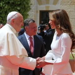 King Abdullah II of Jordan is shown with Pope Francis and Queen Rania.