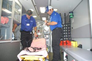 Tim Swann, EMT, and Chris Thomas, Paramedic, are shown in one of the ambulances operated from the new emergency room facility at Baptist Memorial Hospital-Union County.