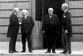 British Prime Minister David Lloyd George, Italian Prime Minister Vittorio Orlando, French Prime Minister Georges Clemenceau and President of the United States Woodrow Wilson in Paris for the peace conference in 1919. George, Clemenceau and Wilson settled things in private meetings and told the other less powerful participants how things were going to be. The Italian PM wasn't invited to most of the meeting with the big guys.