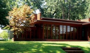 "The building in New Albany has several features similar to ones used by architect Frank Lloyd Wright, but the nearest house actually designed by the controversial architect is this one, the Rosenbaum House, about 100 miles from New Albany in Florence, AL. This detail view of the portion of the Rosenbaum House shows its double cantilevered roof. Wright designed the house for Stanley and Mildred Rosenbaum. It was completed in 1940 and is considered one of the best examples anywhere of the smaller ""Usonian homes Wright built around the country starting in the 1930s."