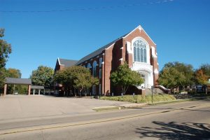 This photo was taken in early fall before any demolition work was done. When work is complete the view of the church complex from the front will be very nearly the same as before the old porte cocher was demolished.