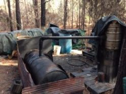 """""""Untended, no fire under the cooker; four 55-gallon barrels of mash doing their silent work."""""""
