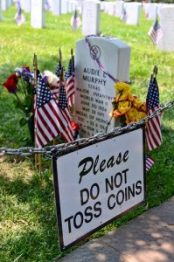 Audie Murphy gravesite, Arlington National Cemetary. Coins should be placed, not tossed...