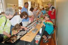 Visitors looking over the wares at the Fossil Roadsow.