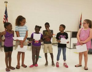 "The 21st Century Community Learning Center Summer Program at New Albany Elementary School included a Writing Club. During the twelve day summer program, these students wrote poems, letters, narratives, research reports, and haikus. On Thursday, June 23, these students chose their favorite piece to share during a ""Publishing Party"". These students read their favorite writing during lunch time to other students in the 21st Century Summer Program. Angela Victory served as the instructor for the Writing Club."