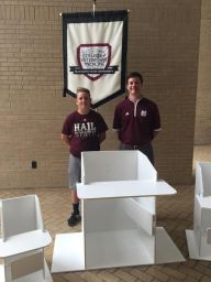 Lews Creekmore presents Bailey Chairs to Jimmy Kight, of MSU Veterinary School.