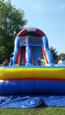Lilli Palmer takes a turn on the bouncy house slide.