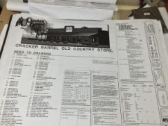 Photo shows the top sheet of a set of drawings for a New Albany Cracker Barrel, which are on file at city hall.
