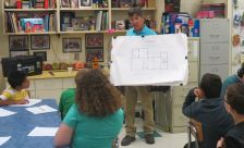 Rick Robbins shows off a floor plan and tells how it is used in construction.