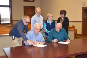 Union County Election Commission members sign their commissions.