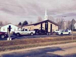 investigators at church robbery