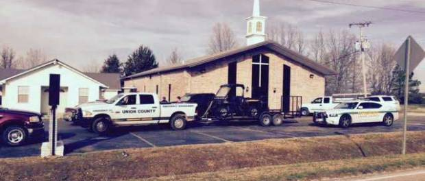 investigators at church robbery