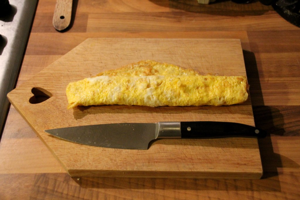 Roll Up Your Egg On A Chopping Board