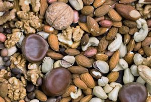 Square background of different kinds of nuts