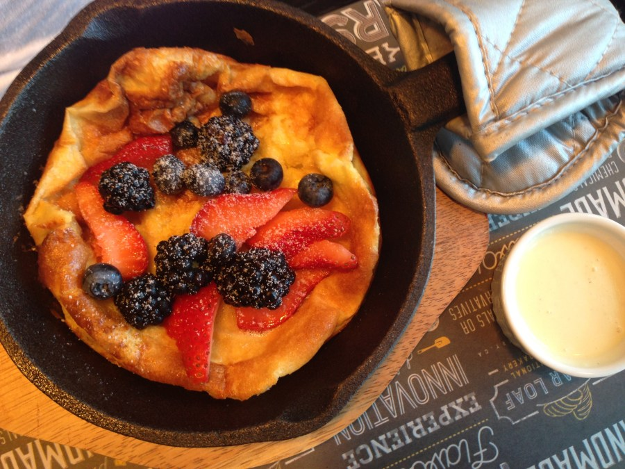 Dutch babies - souffle pancake with fresh fruit and creme anglaise.