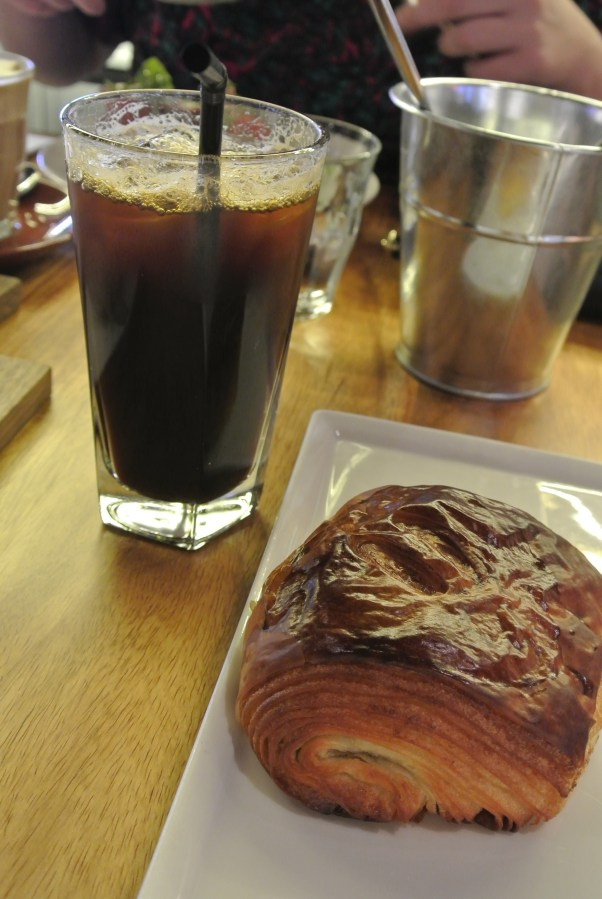Iced coffee and a buttery pain au chocolat.