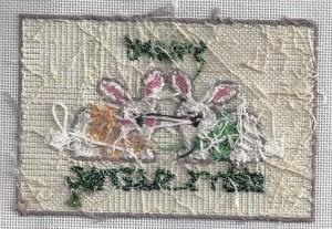 back of stitched needlepoint canvas