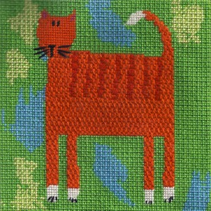 beginning needlepoint canvas of cat. stitched by needlepoint expert janet m. perry