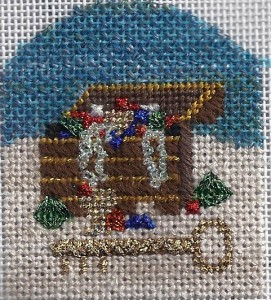 A simple landscape is used as a background in this ornament