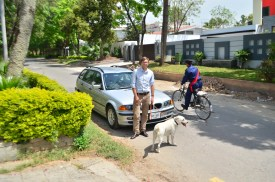 With Oscar and my BMW wagon in Islamabad.