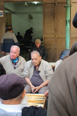 Little old men club behind the market. They were playing various games and drinking coffee.