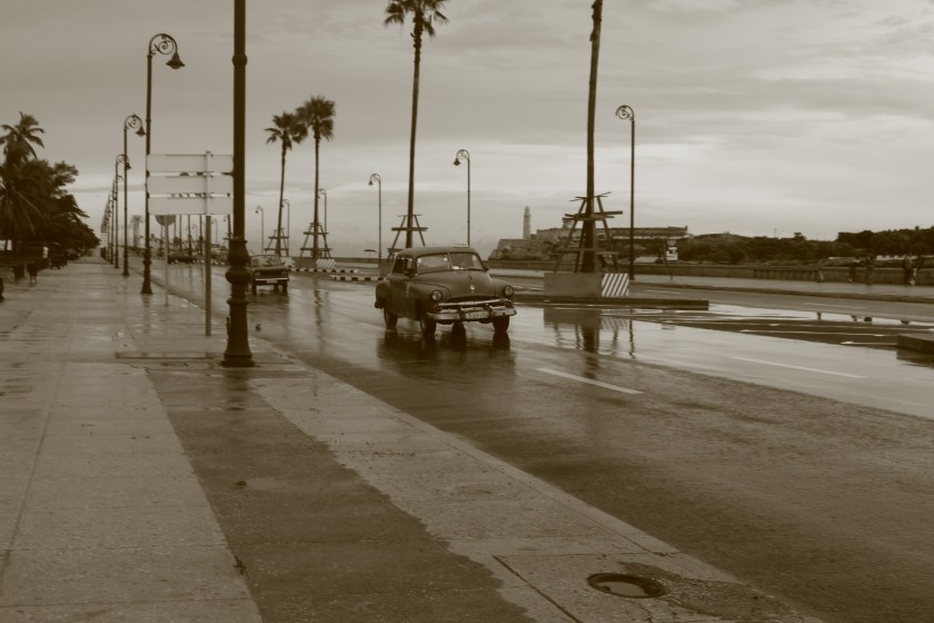 55 old cars on Malecon after the rain by Nneya Richards