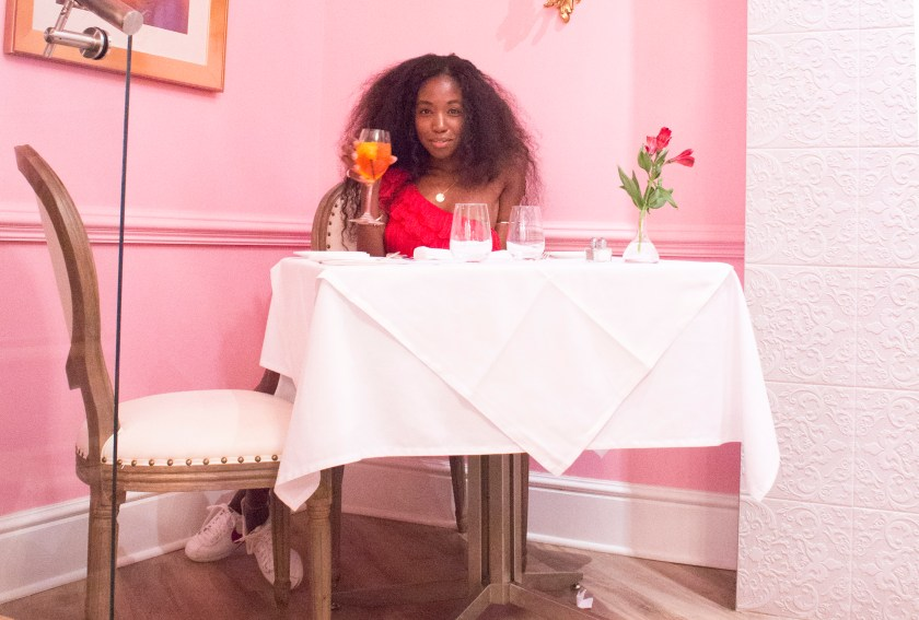 At Table in Pink Room by Nneya Richards