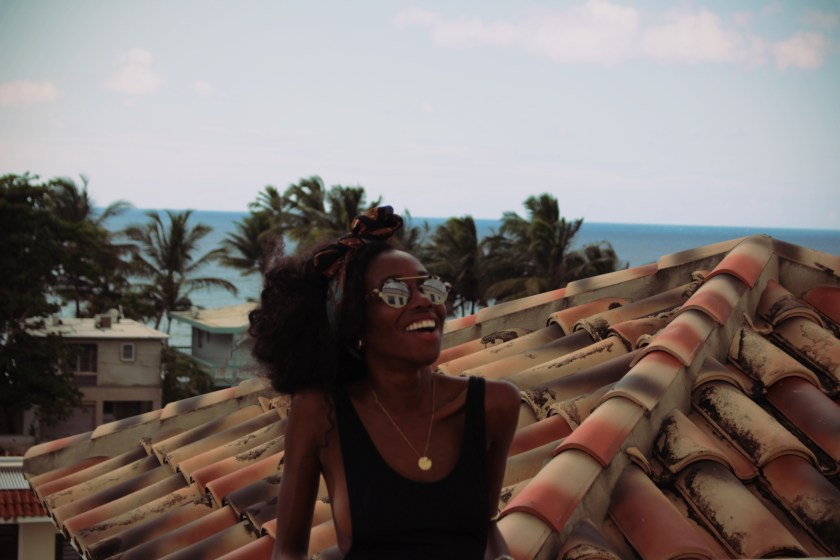 smiing on the roof by Nneya Richards