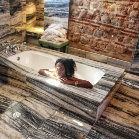 In Marble Bathtub by Nneya Richards