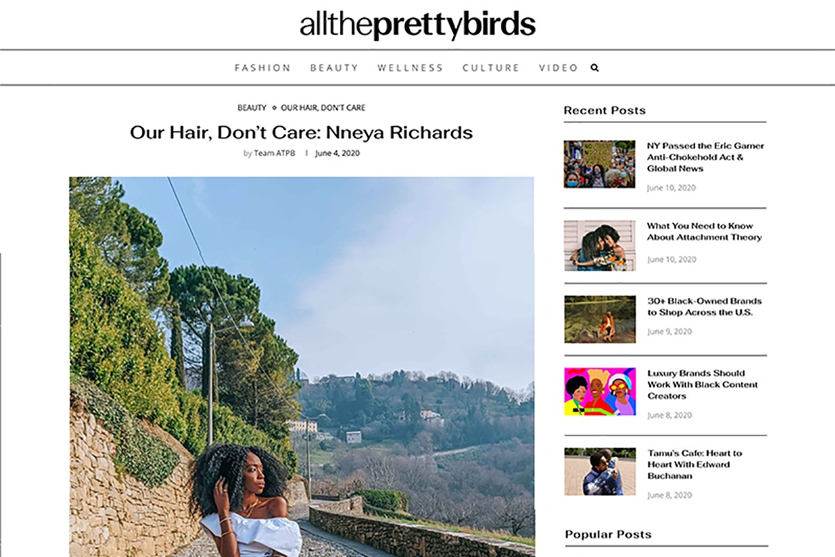 All the pretty birds site screenshot, image of me in Bergamo in white dress with hillside behind