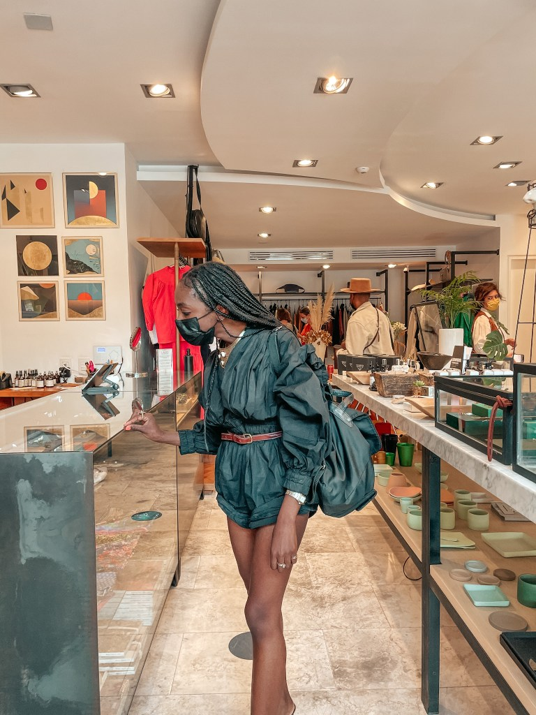 girl shopping in a concept clothing store