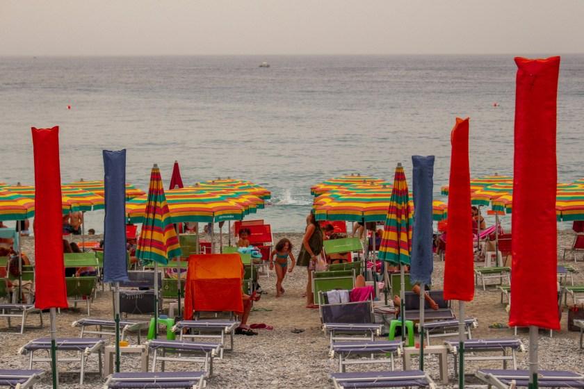 Closed Umbrellas on Beach in Calabria