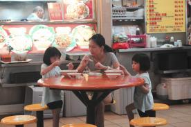family at Maxwell Road Hawker Centre
