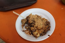 rojak, a delicious salad medley in a savory sweet black sauce topped with peanuts from Rojak, Popiah & Cockle.