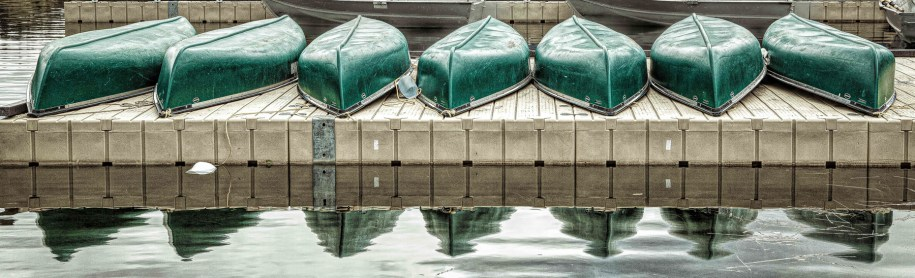 Canoes by Mark Laussade