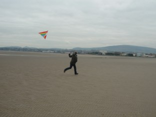 One armed kite flyer.