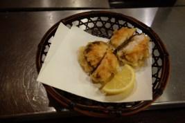 Shitaki mushroom stuffed with shrimp.