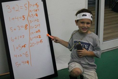 Dawson shows that he can add with ease as a early kindergarten student