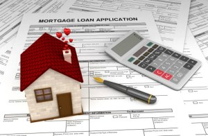 mortgage application, pen, calculator, and model house