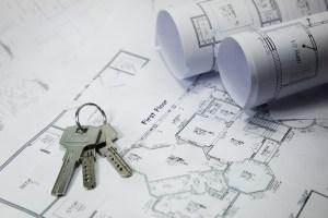 house keys lying on house blueprints