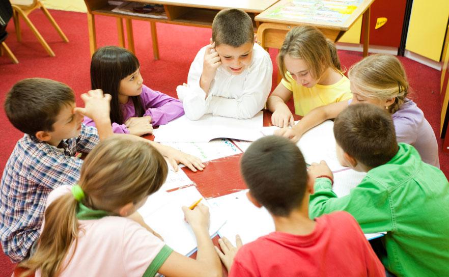 Model Collier County Schools - elementary school children working in a group