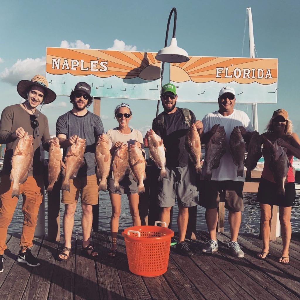 Many fishermen with many fish