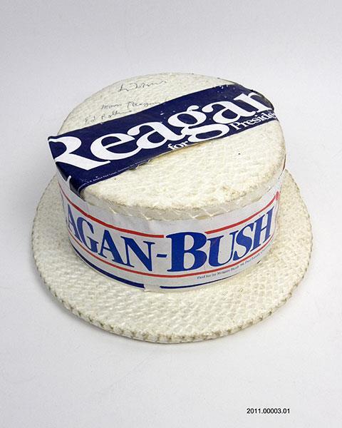 Reagan-Bush campaign hat with bumper sticker, 1980. Reagan Library.