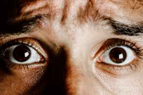 brown eyes of scared young person, treatment of nervous breakdown