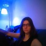 a photo of laurel green under a blue light